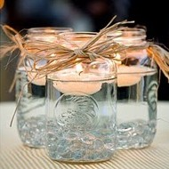 Mason jars with floating tea lights