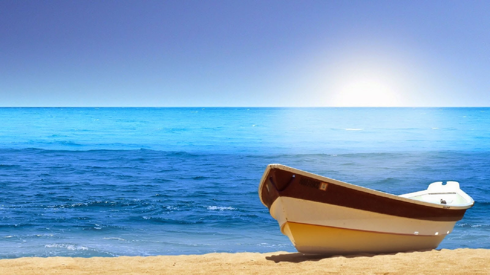 small-boat-on-white-sand-clear-sky-blue-sea-photo-image.jpg