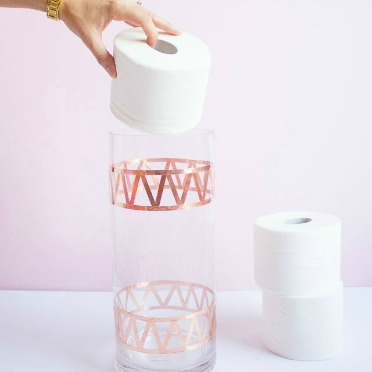 A vase turned chic toilet paper storage!