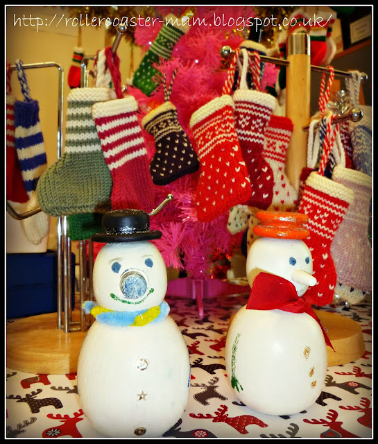 hand knitted mini Christmas stockings and mini wooden snowmen