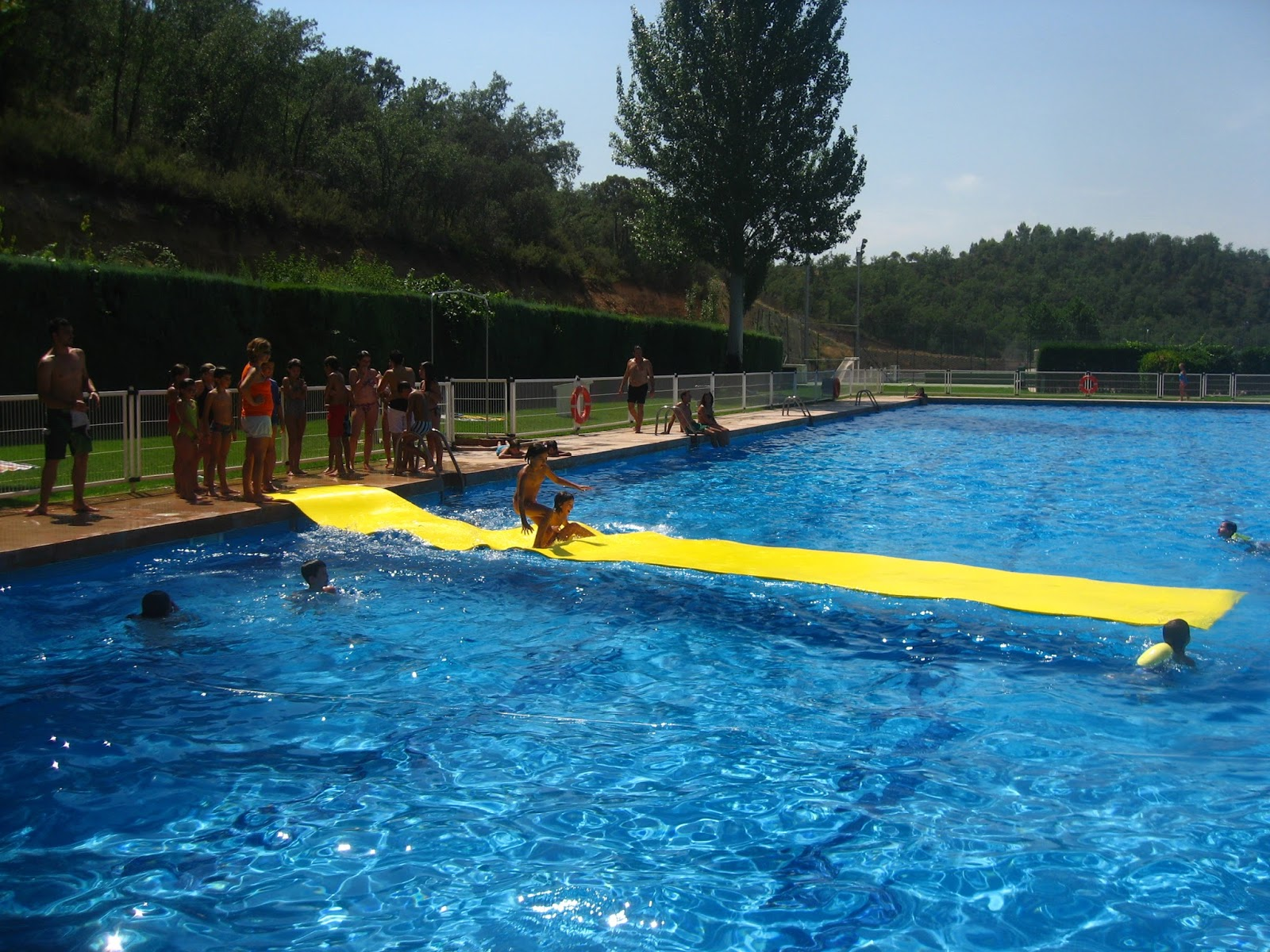 Club canicross guadalajara ii campamento de canicross en for Piscina municipal san roque