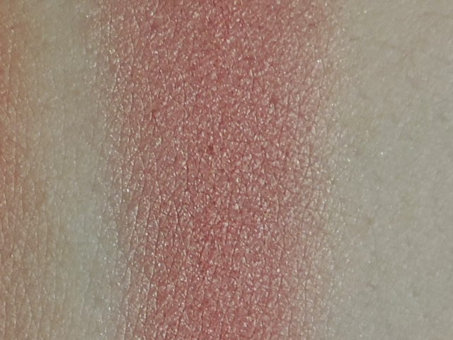 Swatch of Makeup Geek blush in Romance