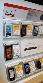 Cell phone options displayed on a wall display