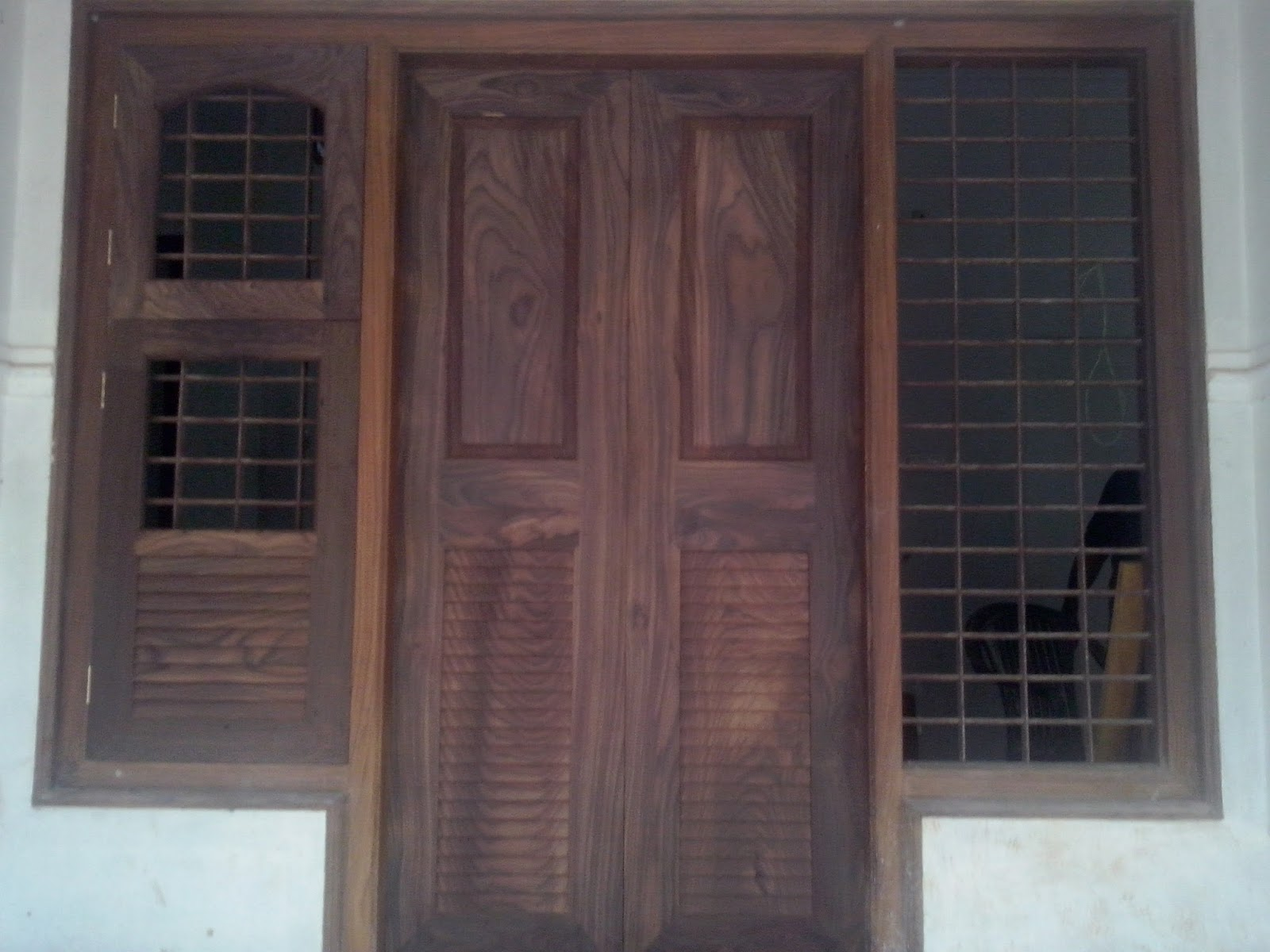Kerala style carpenter works and designs front entrance for Double door designs for home