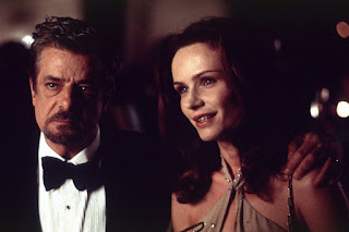 Giancarlo Giannini as Rinaldo Pazzi accompanied by wife Allegra Pazzi (played by Francesca Neri), Hannibal, Directed by Ridley Scott