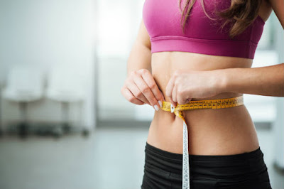 How to Get a Flat Belly Without Dieting or Exercising