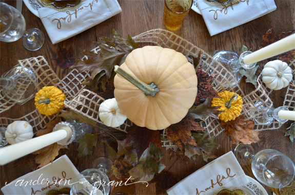 Thanksgiving centerpiece featuring pumpkins, gourds and leaves | www.andersonandgrant.com