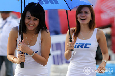 Pretty and sexy umbrella girl in INDOPRIX 2011 series II