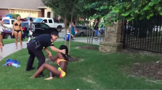 American Policeman is assaulting a  black teenage girl