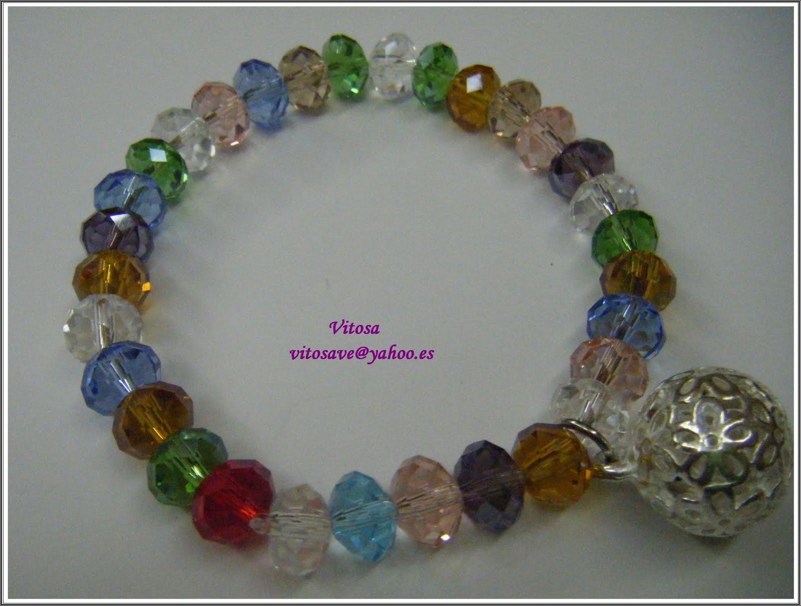 Pulsera Piedras Facetadas Distinta gama de color de 6 Mm. Con La llamada de los Ángeles. Una antigua leyenda céltica dice, que al sonar las campanas de la