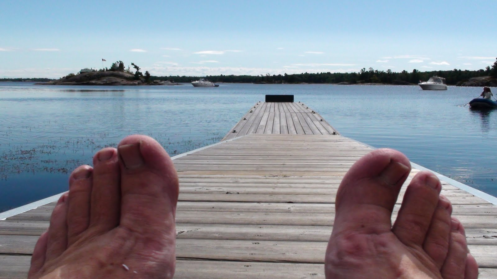 Dock in water looking through the feet