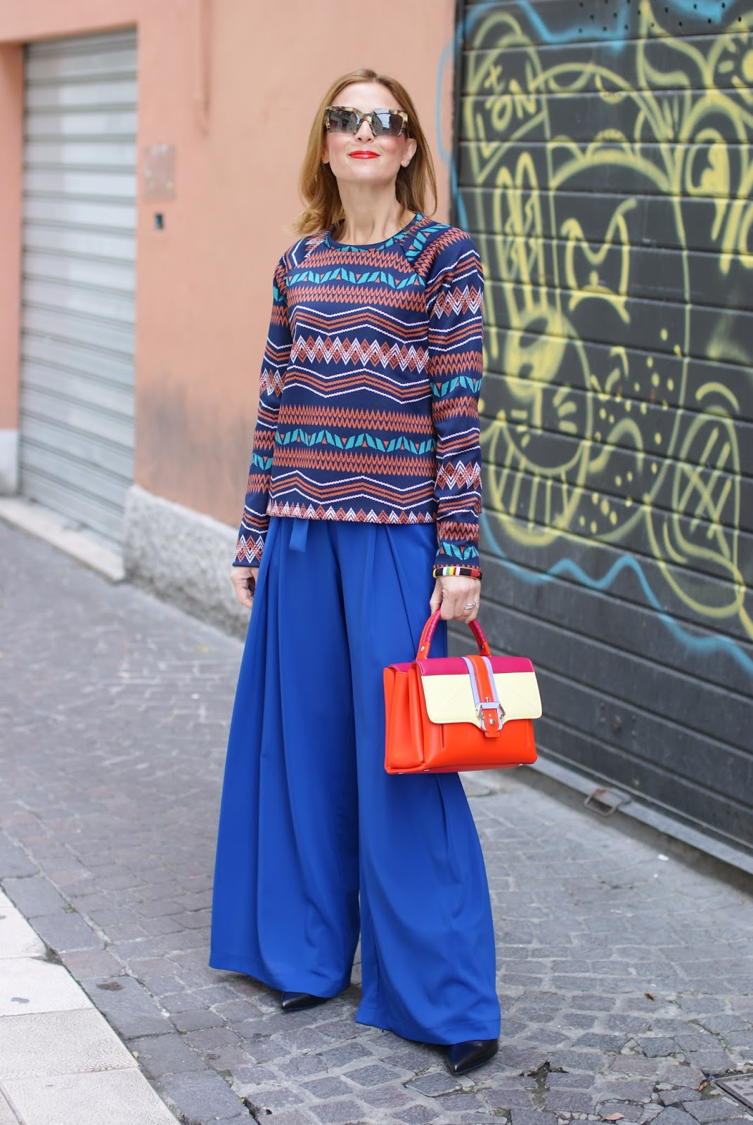 Colorful outfit with wide leg palazzo pants and Paula Cademartori Petite Faye bag on Fashion and Cookies fashion blog, fashion blogger style