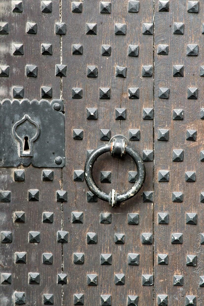 old wooden door with ironworks