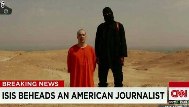 الدولة الاسلامية تذبح ضابطا أمريكيا في العراق والقتيل قبل وفاته واشنطن هي المسؤولة