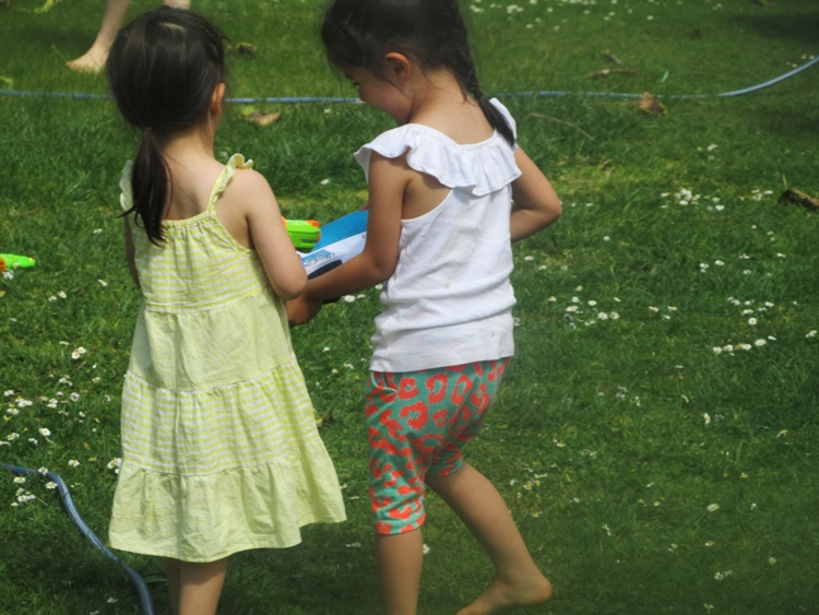 The cutest little guests at their first ever waterfight