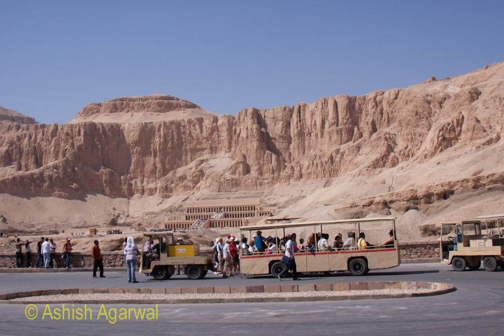 View of the electric buses against the temple of Queen Hatshepsut in Deir El Bahri