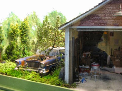 miniature garage and old car