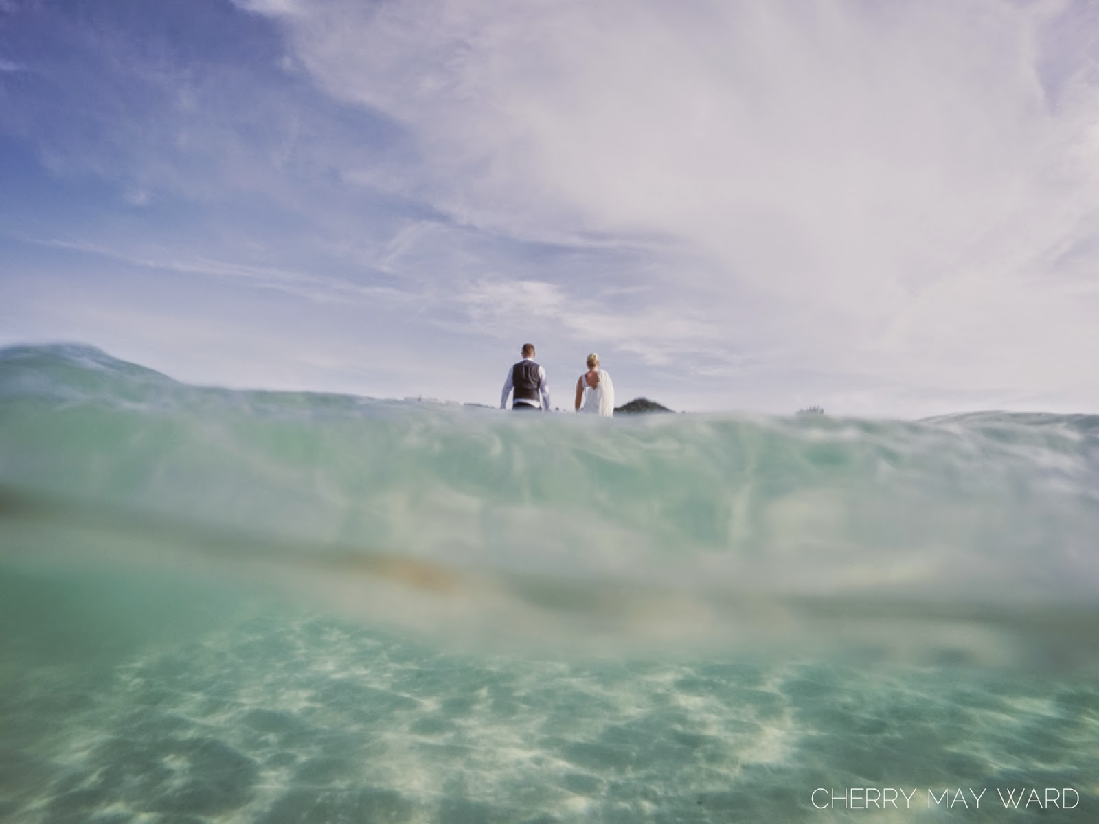 bride and groom walking away after finishing trash the dress session on Koh Samui, Chaweng beach, Thailand, professional underwater photos on Koh Samui