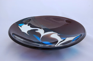 Fused glass bowl with combed design