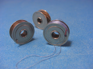 http://sewingpartsplus.ecrater.com/p/20617561/vintage-singer-white-kenmore-sewing?keywords=Vintage+Singer+White+Kenmore+Sewing+Machine+One+Hole+Bobbins+%23744+Set+of+3