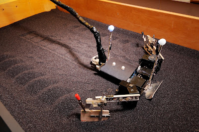 FlipperBot moves through a bed filled with poppy seeds in the Georgia Tech School of Physics. The research, which also included a study of sea turtle hatchlings, provides new information on the principles governing locomotion on granular surfaces. Credit: Gary Meek