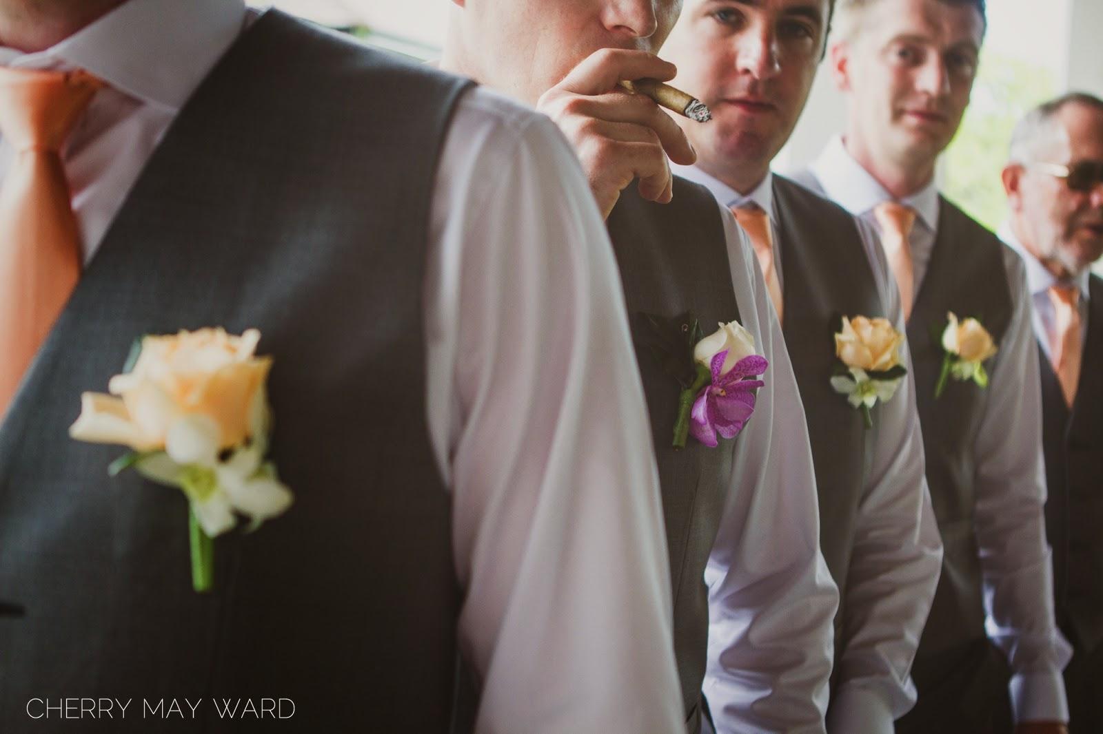 groom smoking a cigar, groom and groomsmen button holes, wedding detail ideas for Thailand wedding, Koh Samui wedding photographer,