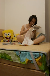 University student doing arts and crafts surrounded by sponge bobs Shanghai 2009