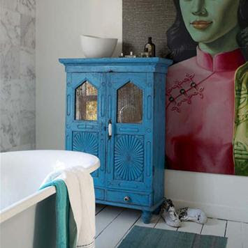 blue accent is all you need love this blue cabinet in the bathroom
