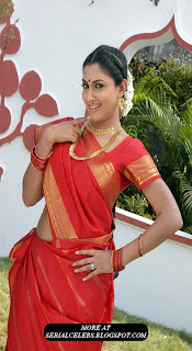 Malavika in red low hip saree
