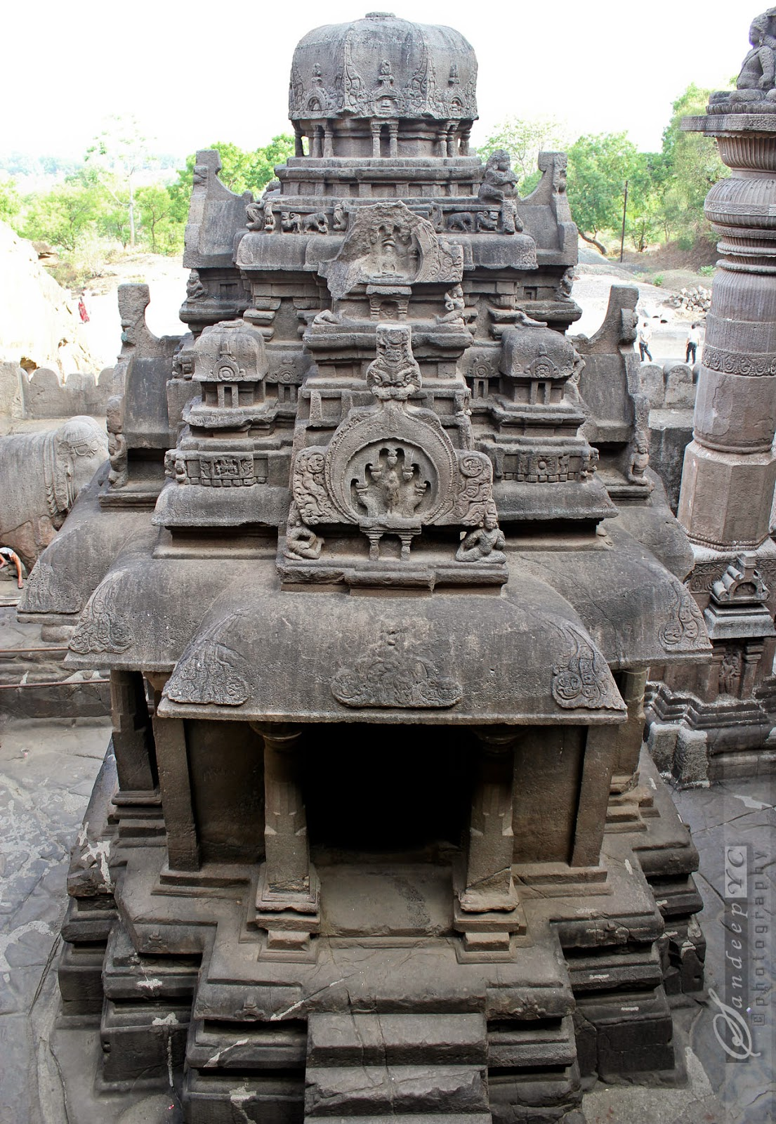 exquisitely carved monolithic shrine at the center of the courtyard