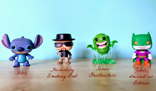 Morgan's Milieu | Pop! Vinyl Figure Review: A photo of four vinyl figures - Stitch, Heisenberg from Breaking Bad, Slimer from Ghostbusters and the Joker dressed as Batman.