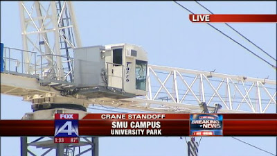 An armed man reportedly barricaded himself inside the cab of this crane on the SMU campus.