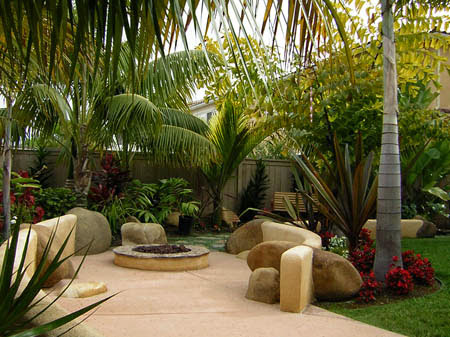 backyard patio idea with a tropical theme backyard