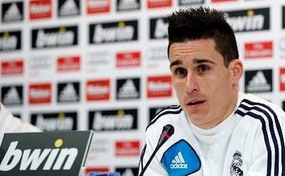 Jose Callejon at press conference with Real Madrid jersey