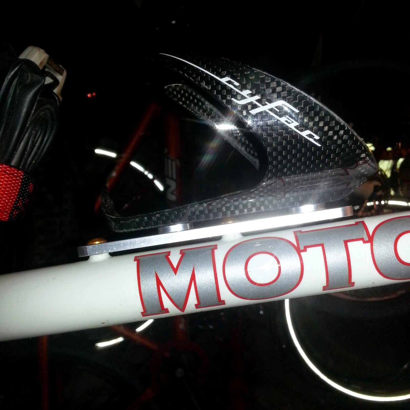 Mount Skidmore Bottle Cage Adapter on the FCU