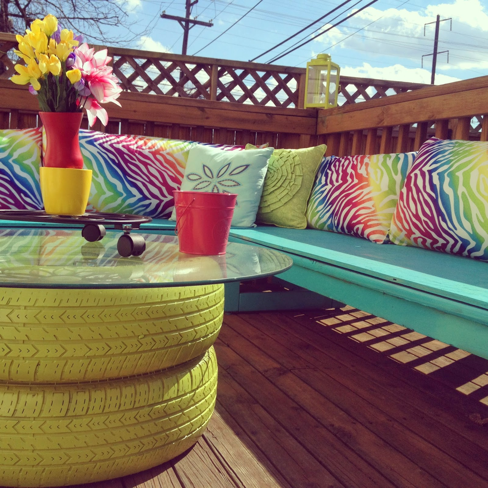 Colorful DIY outdoor deck seating benches makeover with tire table