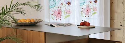 Welche Arbeitsplatte zu einer Küche mit Holzfronten im Landhausstil?