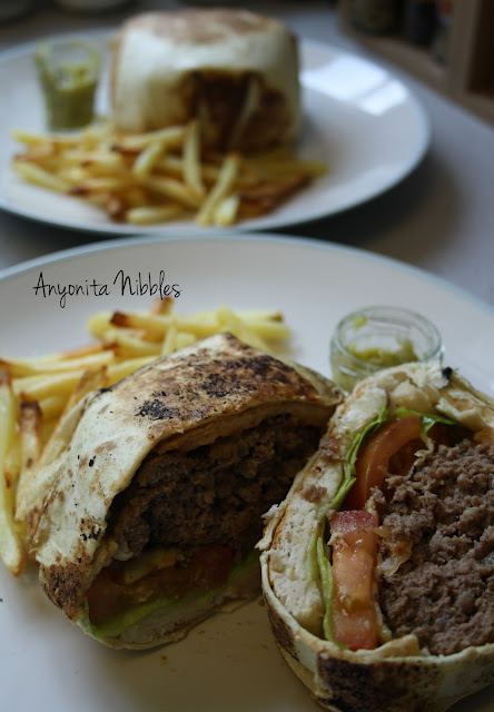 A cut tortilla wrapped fiesta Mexican burger
