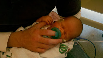 02/09/2011 - Holding dad's thumb, holding hands for the first time