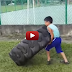 7 years old kid lifted 150kg tyre