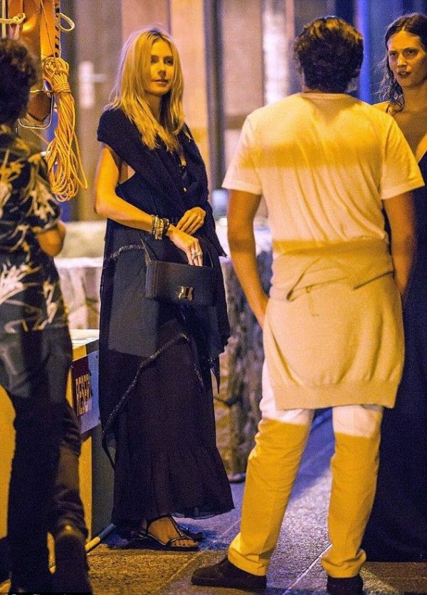 Well, isn't that cute? Heidi Klum stunned in a dark maxi dress with a sweet shawl and just a pair of sandals, smiling as they spent the New Year 2015 at Saint Barthelemy on Monday, December 29, 2014.