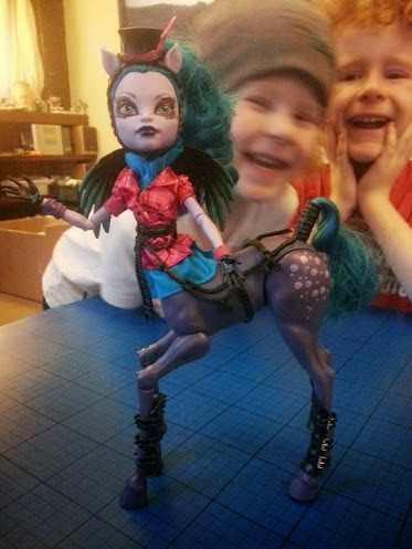 Monster High Freaky Fusion Hybrid Avea Trotter Doll with daft lads behind