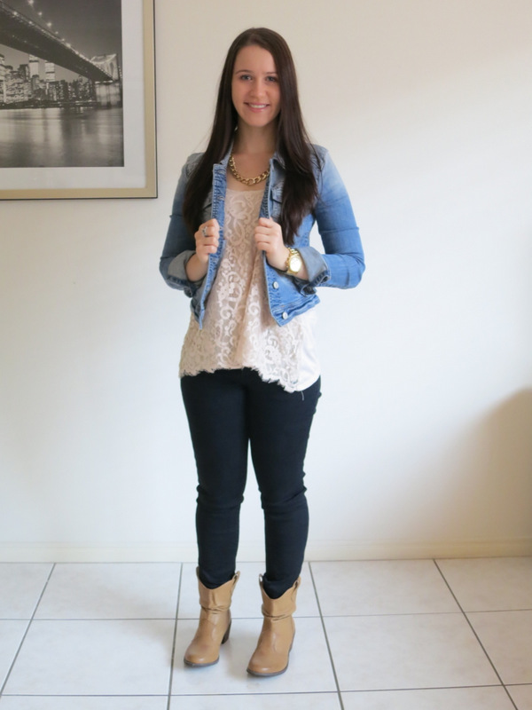 Black jeans with a cream flowy singlet top and denim jacket, brown boots and gold jewellery