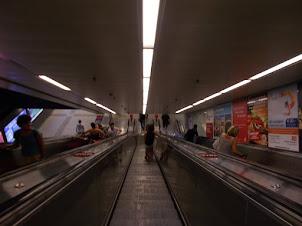 Escalators to the underground metro platforms.
