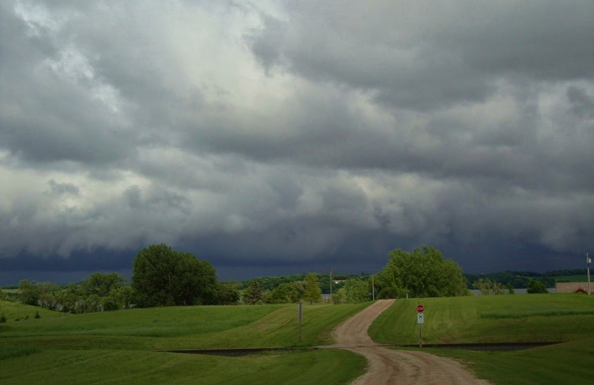 rain over the Minnesota farm lands near Pelican Rapids