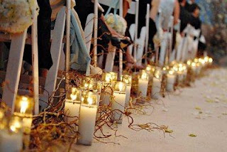 candle lined wedding aisle