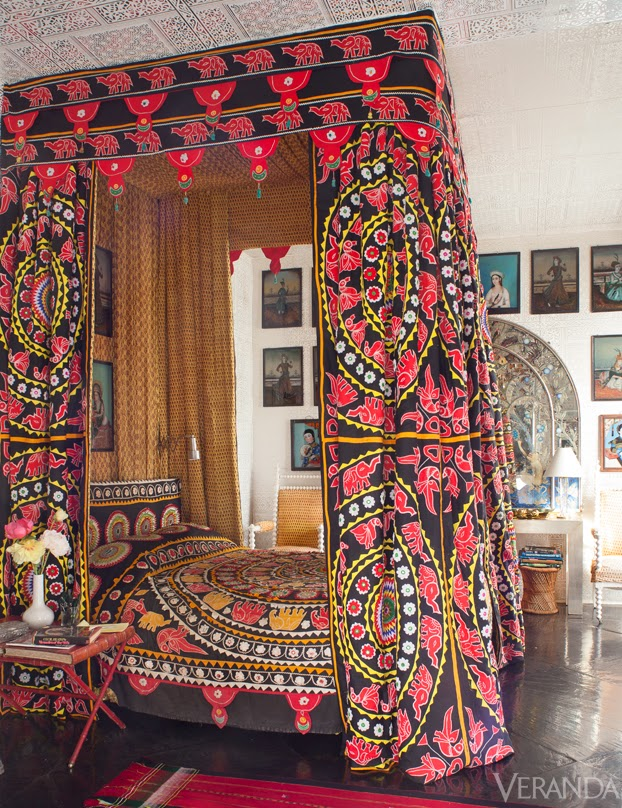 Vintage appliquéd textiles from India are repurposed into a canopy and bed dressings.