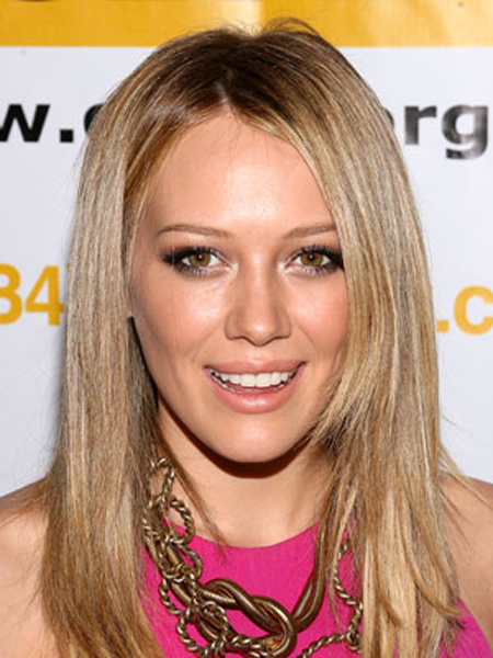 Hilary Duff's super-straight strands have a messy part and soft face-framing layers