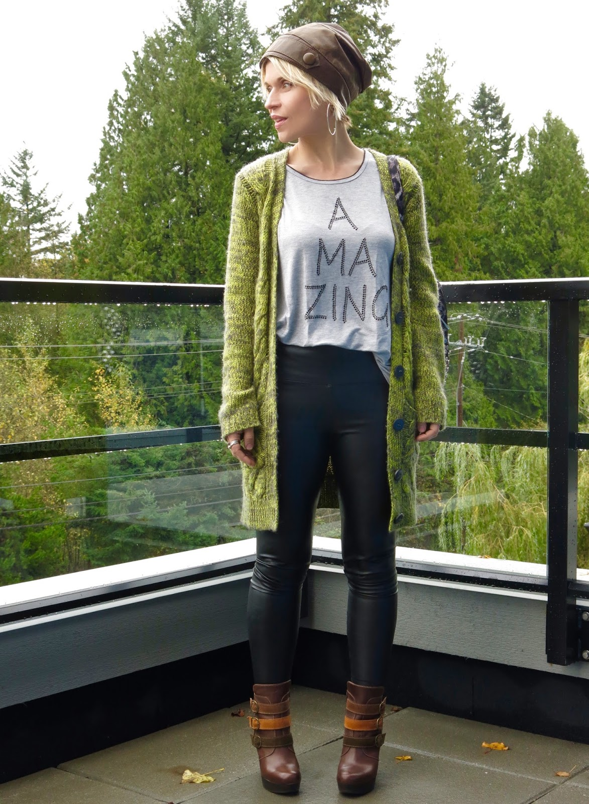 styling faux-leather leggings with platform booties, a grandpa cardigan, and leather beanie