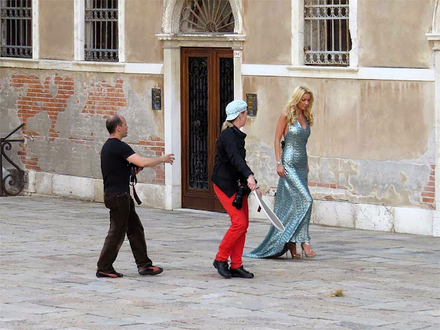 Model and photographer at work, Campo Santo Stefano, Venice